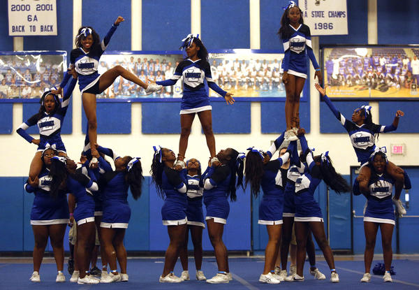 Fort Lauderdale High school cheerleaders compete in the state regional cheerleading competition at Dillard.
