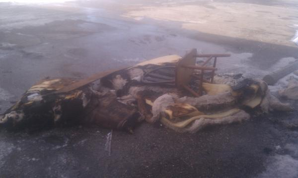 Damaged furniture sits outside an apartment building today after a fire at 1601 Olive Drive.