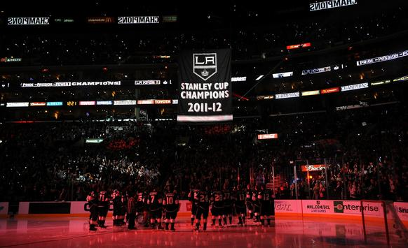 The Kings lift their heads to watch the Stanley Cup banner make its way to the rafters at Staples Center.