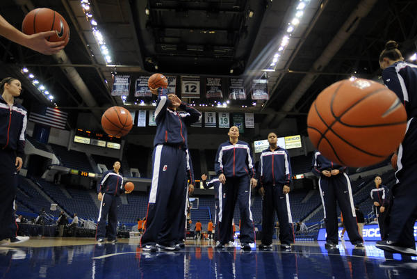 UConn forward Kaleena Mosqueda-Lewis (center) gets ready to launch the ball during team warmups before their Big East matchup with Syracuse at the XL Center in Hartford Saturday.