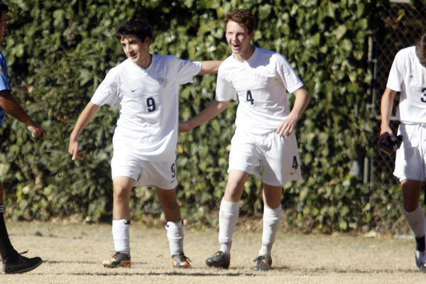 Flintridge Prep's Ari Baraian, left, and Daniel Enzminger hug each other after their team makes a point during a game against Pasadena at Flintridge Prep in La Canada on Saturday, January 19 2013.