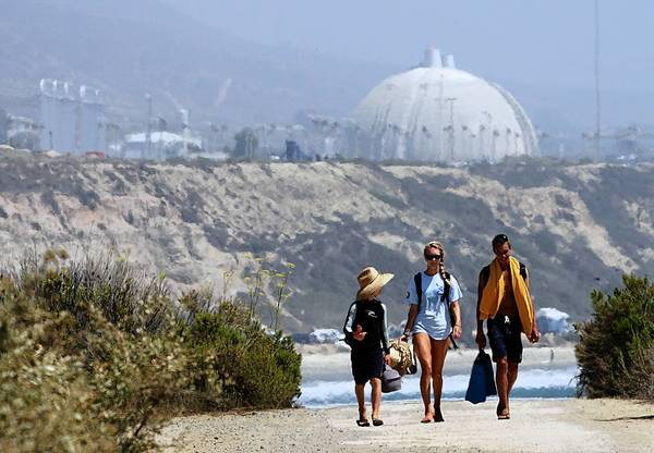 Children walk on a trail near the San Onofre nuclear plant. The environmental group Friends of the Earth made its case to federal regulators that Southern California Edison should be barred from restarting the plant unless it goes through a trial-like hearing process.