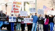 People crowded the sidewalk and spilled into West King Street across from U.S. Sen. Joe Manchin's office in Martinsburg on Saturday for a Second Amendment rally and protest.