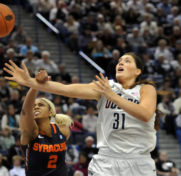 UConn's Stephanie Dolson gets fouled by Syracuse's Elashier Hall in the second half at the XL Center in Hartford Saturday. Dolson scored 25 points and had 9 rebounds in UConn's 87-62 win.