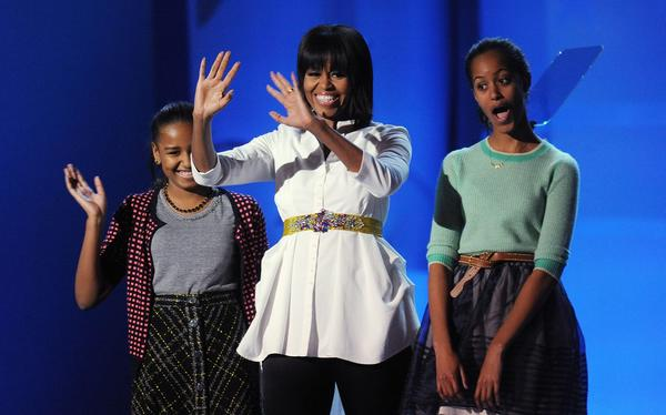 First lady Michelle Obama and daughters Sasha, left, and Malia attend the Kids Inaugural Concert on Saturday.