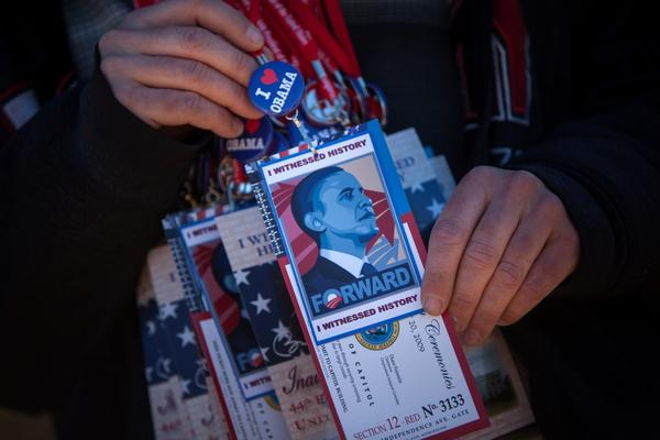 A man sells souvenir passes to President Obama's inauguration ceremonies.