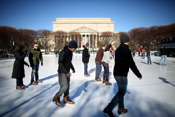 People skate at the National Gallery of Art Sculpture Garden Ice Rink as Washington prepares for the inauguration. Monday's temperature is forecast to be in the 30s with a chance of snow.