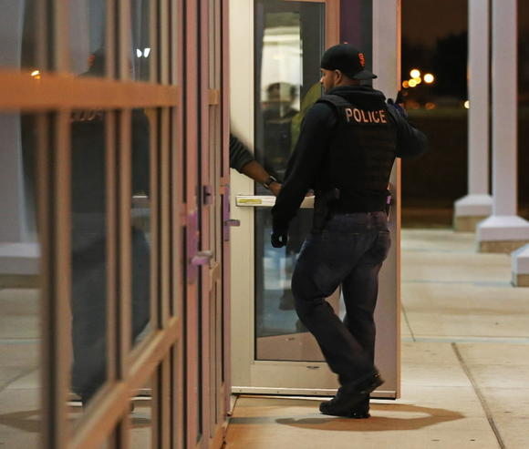 A law enforcement officer enters Chicago State University Wednesday after 17-year-old Tyrone Lawson was killed in the parking lot after the Simeon-Morgan Park boys basketball game.