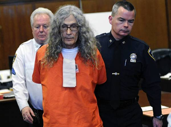 Convicted serial killer Rodney Alcala appears in court in New York. He was sentenced to an additional 25 years to life in prison after pleading guilty to killing two young women there in the 1970s.