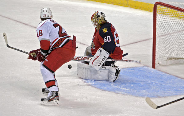 Florida Panthers goalie Jose Theodore stops the puck in front of Carolina Hurricanes Alexander Semin during the third period.