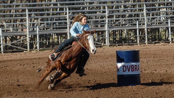Victoria Wysocki makes her way around a barrel during her run in a California High School Rodeo Association District 8 rodeo Saturday afternoon at the Cattle Call Arena in Brawley.
