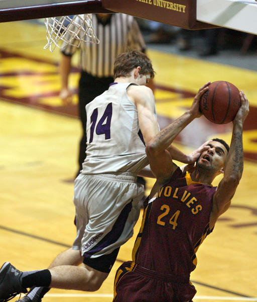 Northern State University's Collin Pryor, right, gets fouled by the University of Sioux Falls' Keaton Moffitt during Saturday night's game at Wachs Arena.