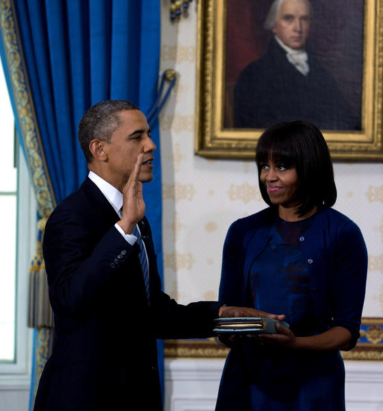 President Obama takes the oath of office as frst lady Michelle Obama holds a bible during the official swearing-in ceremony at the White House in Washington.