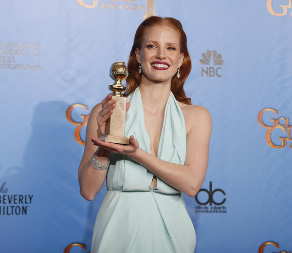 Jessica Chastain, winner for Best Actress in a Motion Picture, Drama for 'Zero Dark Thirty,' poses with her award backstage at the 70th annual Golden Globe Awards.