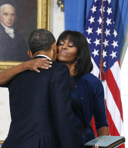 President Barack Obama gets a hug from first lady Michelle Obama after Sunday's swearing-in ceremony.