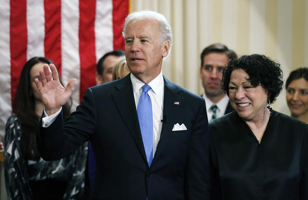 Vice President Joe Biden (L) stands with U.S. Supreme Court Justice Sonia Sotomayor after taking the oath of office during the official swearing-in ceremony at the Naval Observatory on January 20, in Washington, DC.