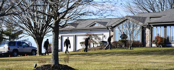 Authorities on Friday investigate a homcide and home invasion robbery at home at 321 Swartley Road in Hilltown, Bucks County.
