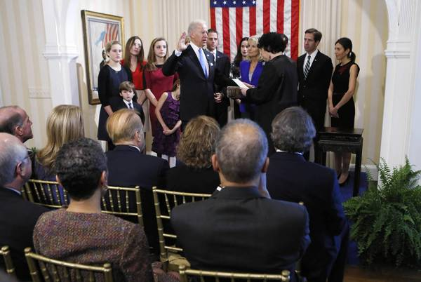 Vice President Joe Biden takes the oath of office from U.S. Supreme Court Justice Sonia Sotomayor as his wife Dr. Jill Biden looks on during the official swearing-in ceremony at the Naval Observatory in Washington, DC. Biden and U.S. President Barack Obama will be officially sworn in a day before the ceremonial inaugural swearing-in.