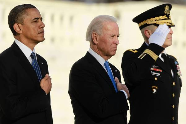 President Barack Obama and Vice President Joe Biden listen to taps being played after laying a wreath at the Tomb of the Unknown Soldier at Arlington National Cemetery near Washington. Obama will take the official oath of office in a small, private ceremony at the White House on Sunday, setting a more subdued tone for his second inauguration than his historic swearing-in four years ago.