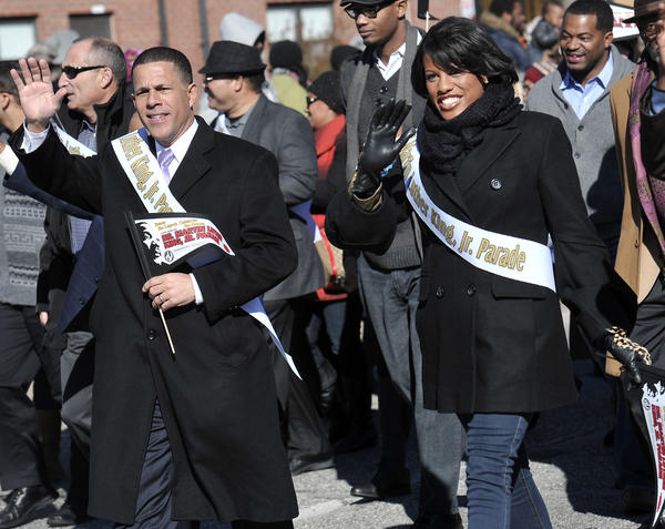 Maryland Lt. Gov. Anthony Brown and Baltimore Mayor Stephanie Rawlings-Blake wave to the crowd as they march in the parade.
