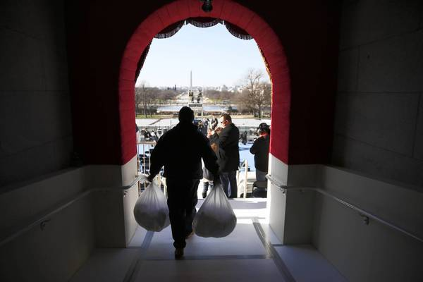 In a view looking west from inside the Capitol, a worker carries bags of rags to the west front of the U.S. Capitol in preparation for Monday's ceremonial inauguration of President Barack Obama. This is the tunnel where Obama will emerge from when he walks out for the oath of office.