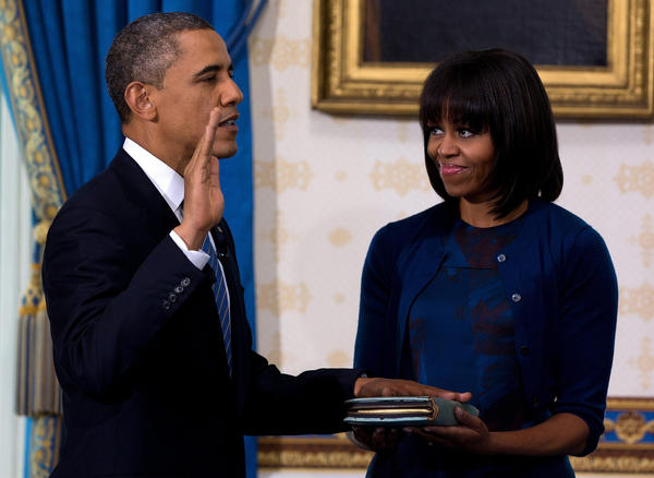 President Obama takes the oath of office as frst lady Michelle Obama holds a bible during the official swearing-in ceremony at the White House.