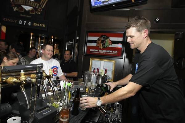 Ex-Cubs pitcher Kerry Wood serves drinks at his Woody's Winter Warm-Up fundraiser Jan. 18, 2013 at Harry Caray's Tavern at Navy Pier.