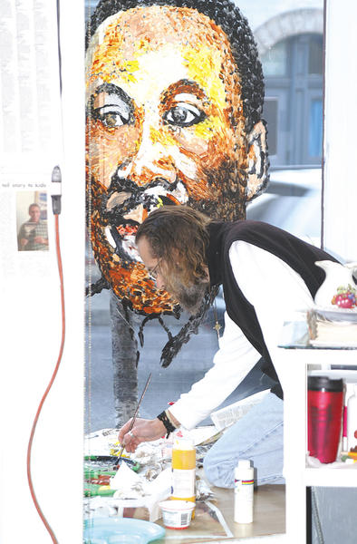 Local artist Morgan Ballard painted a mural of Martin Luther King Jr. on a window at Contemporary School of the Arts and Gallery Inc. On Jan. 15, two dozen people attended the ninth annual Martin Luther King Jr. Day celebration at the gallery in downtown Hagerstown. Each speaker talked about what  King meant to them and what King accomplished during his era. Ron Lytle, executive director of the gallery, would like to thank Taste Budz restaurant, Mr. and Mrs. James Neville, the City of Hagerstown and Hagerstown-Washington County Convention and Visitors Bureau for helping sponsor the event.