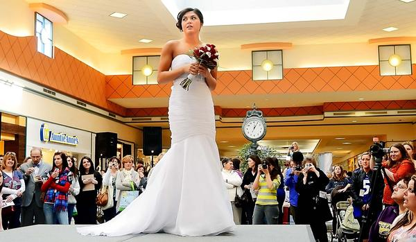 Janel McClurg models a wedding dress at The Herald-Mail's 2013 Bridal & Prom Expo at Valley Mall on Sunday.