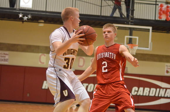 Victoria senior Dalton Dreiling looks past Hoisington junior Trent Schremmer (2) in Saturday's Winter Jam title game. Dreiling scored 18 points in the semifinals against Ellinwood.