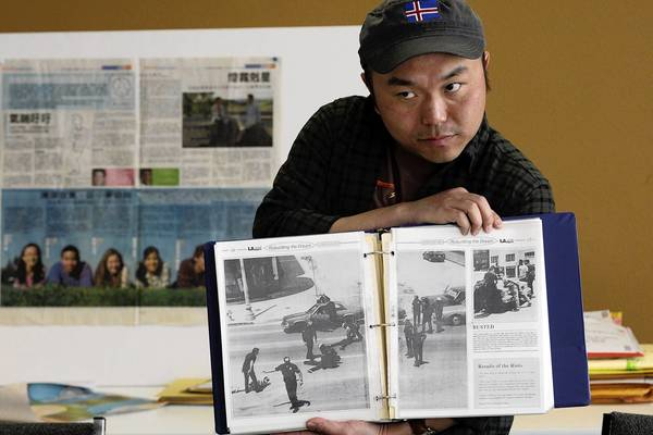 Mike Fricano, one of the editors of L.A. Youth, shows old copies of the student newspaper, which after a 25-year run has published its last issue because of financial struggles.