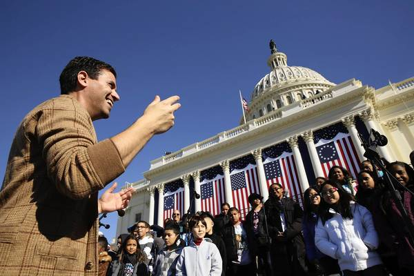 Gregg Breinberg directs the PS 22 School Chorus from Staten Island, New York on the west front of the U.S. Capitol in preparation for Monday's ceremonial inauguration of President Barack Obama.