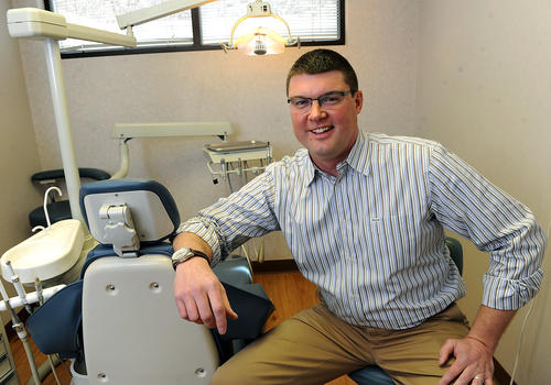 David Wyke, D.M.D. a forensic dentist, who works with the Coroner's in Lehigh and Northampton Counties to to help Identify victims by using dental comparisons in his Walnutport  dental office Wednesday.