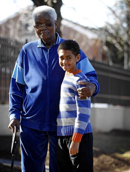 Owen Gibson, 87, of Oak Park, and Cameron Alexander Romero, 12, of Chicago, met for the first time Sunday. The two take pride in President Barack Obama's rel-election and plan to attend inaugural events Monday in Washington, D.C.