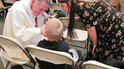 Bishop Alphonse Mascherino and Vicki Reese speak to Reese's son, Cody Reese.