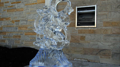 A Kraken ice sculpture stands beside the frozen sea god, Poseidon, in front of the Somerset Trust Company.