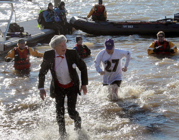 Dressed in his finest tuxedo, Havre de Grace Mayor Wayne Dougherty runs from the cold Chesapeake after taking a dip at Saturday's second annual Havre de Grace Duck Dunk at Tyding Park.