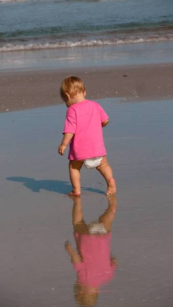 Eleven-month-old Trillian Fischler practices her new walking skills on the beach.