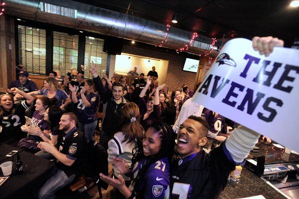 Ravens fans at the Charles Village Pub in Towson celebrate the team's victory over the New England Patriots to earn a berth in Super Bowl XLVII.