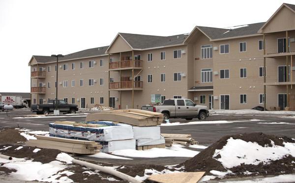 Work continues at Dakota Estates, a 64-unit apartment building on North Dakota Street. American News Photo by John Davis