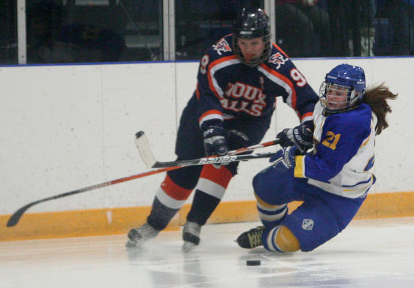 Aberdeen Cougars Madyson Ogdahl, right, gets knocked down by Nikia Bradley, left, of the Sioux Falls Flyers on Sunday at the Odde Ice Center.