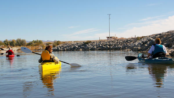 FROM LEFT: State Park Interpreter Fredda Stephens and volunteer Connie Brooks paddle behind visitors during a kayaking trip of the Salton Sea Sunday, the last day of the first Birding Festival at the Salton Sea State Recreation Area. The festival is the latest effort to bring awareness and increase visitation to the Salton Sea State Recreation Area, which avoided closures last year.