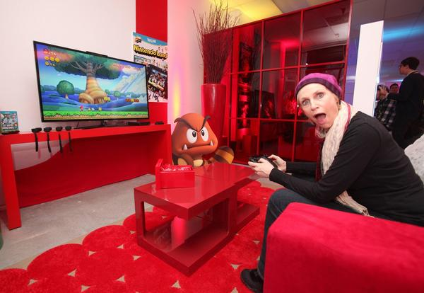 Actress Jane Lynch warms up and checks out Wii U at the Nintendo Lounge.