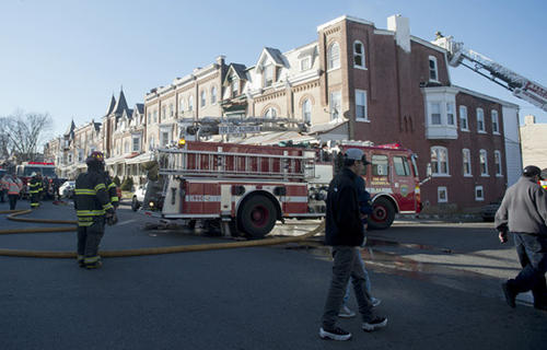 A fire in a group of row homes on the 500 block of Washington Street in Allentown on Sunday.