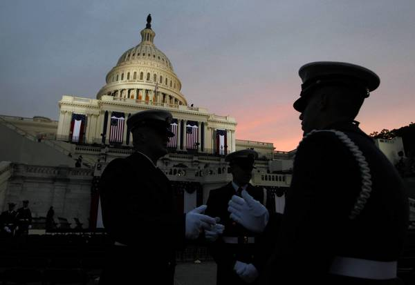 The sun rises as the U.S. Capitol is readied for the ceremonial inauguration of President Barack Obama.