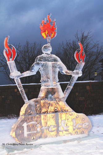 Holding torches and breathing fire, this ice warrior sculpture stands by the entrance proclaiming the start of the Ice & Spice event in Bay Harbor. Ice sculptures created in the competitions line the avenue in Bay Harbor for the public to see and will remain as long as weather permits.