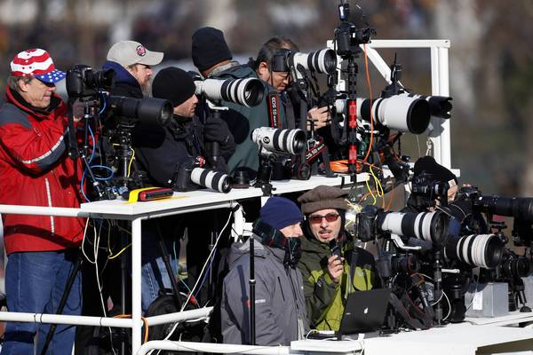Photographers on the center stand prepare for the ceremonial inauguration of President Barack Obama at the U.S. Capitol.