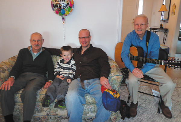Four generations John Walck of Greencastle, Pa., celebrated his 80th birthday, Sunday Jan. 6, at his home. All family members were present except grandson Greg Walck, who lives in North Carolina. There were four generations of the Walck family included in the 19 people who attended. Larry Walck played his guitar and sang a special song for his dad called, We are Blessed. He also led the singing of Happy Birthday. John worked for Hagerstown Canteen Service, Inc. for 50 years, retiring in 2003. From left are John Walck; great-grandson Julian Walck; grandson Eric Walck; and son, Larry Walck.