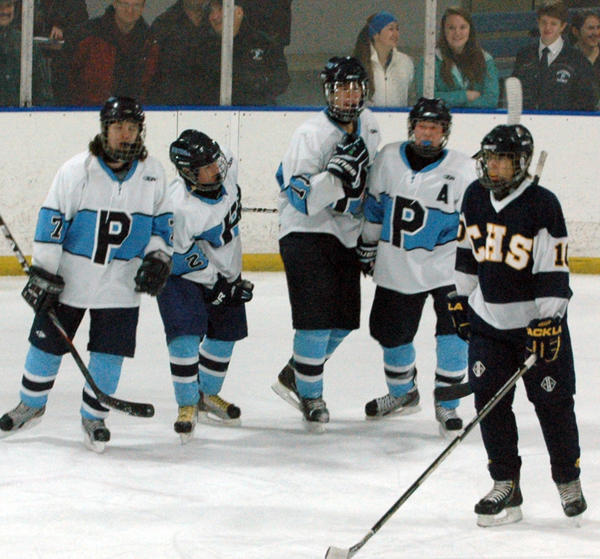 Petoskey senior defenseman Ken Forton (middle) celebrates his second period goal against Cadillac with teammates (from left) Nik Kolodziej, Mike Forton and Tanner Davis Friday at Griffin Arena