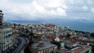 "Naples –its name comes from the Greek ""neapolis"" or new city—is located in the region of Campania in southern Italy, about two hours south of Rome, on the northern edge of the beautiful Bay of Naples. Views of the majestic, 7,000-foot-high Vesuvius volcano greet passengers as their ship arrives in Naples, southern Italy's most important port."